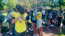 IMAGE: Parents give hugs, TLC to UNC-Chapel Hill students in wake of suicides