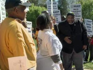 Members of the state NAACP protested the decision by four Wake County school board members to attend a budget training session sponsored by a conservative group.