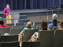 Susan Pullium of the Wake schools student assignment task force speaks to parents during a meeting on Aug. 31, 2011, at Middle Creek High School.