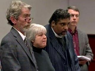 Rev. Nancy Petty, Rev. William Barber and  Scott Bass, far right, appear in Wake County District Court with their attorney on March 2, 2012, to plead guilty to charges of second-degree trespassing.