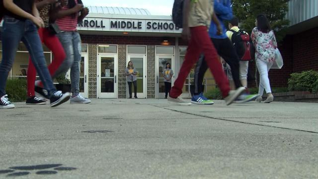 Students arrive at Carroll Middle School in Raleigh on Aug. 24, 2015, for the first day of the 2015-16 school year.