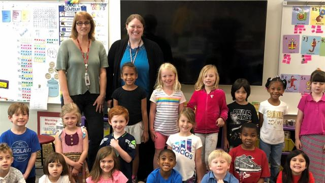 Teacher April Guenzler, in black sweater, was named the top magnet school teacher in the U.S.