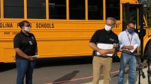 IMAGE: Masks, spacing and a promise from parents required when Wake students board the bus