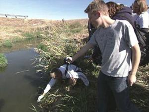 Clearfield High School students test water quality  near Hill Air Force Base in Utah.