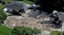 Florida sinkhole swallows home and boat parked outside