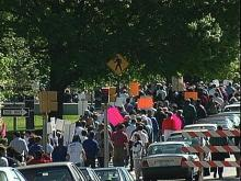 Protestors march in response to Gov. Hunt's announcement.
