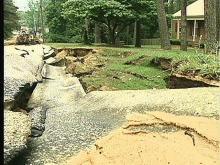 Road Sinks After Water Main Breaks