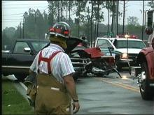 A firefighter looks at the scene where a fatal car crash took place.
