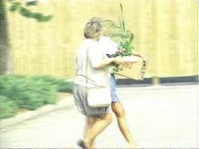 Two Hardee's employees appear to be carrying boxes of personal items as they leave the Rocky Mount headquarters Tuesday. (WRAL Photo)
