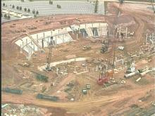 The construction of the new arena is behing schedule, but many people seem to think time will be made up.