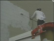 Juvenile Offenders Removing Graffiti