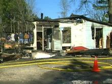 Fire Destroys Apex Store