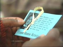 Students distributed cards in an effort to bring awareness to their classmate's disappearance.