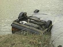 The victims' car flipped down a hill before plunging into the creek on its roof.