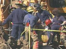 A team of rescue workers from Cary and Morrisville worked for two hours Tuesday to free a trapped construction worker. (WRAL-TV5 News)