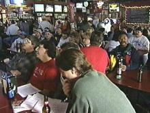 A crowd of people pack the Upper Deck in Cary for the games.