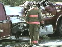 This Benhaven fire truck rolled over on the road, injuring two firefighters. (WRAL-TV5 News)