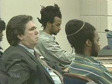 Tilmon Golphin (rear, center) and his brother Kevin (right), listen to testimony in the sentencing phase of their double murder trial in Fayetteville. (WRAL-TV5 News)