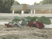 Roses mark the site where Charles Willis lost his life late Monday night. (WRAL-TV5 News)