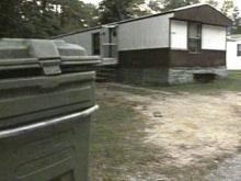 Police arrested three people after the group allegedly robbed migrants at this Spring Lake trailer home. (WRAL-TV5 News)