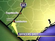 Two police officers were shot Wednesday night along I-95 in Robeson County near exit 10. (WRAL-TV5 News)