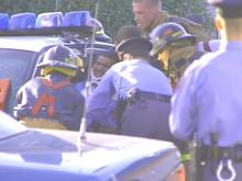 Raleigh Bus Hits Police Car, Trapping Officer