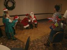 Santa Claus paid a special visit to children at a holiday party at Embassy Suites-Crabtree Valley Sunday.(WRAL-TV5 News)