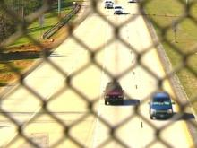 Larger cities with heavy pedestrian traffic have them to prevent people from throwing things into traffic, but John Emerson says North Carolina is too rural.(WRAL-TV5 News)