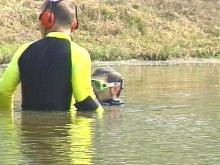 Divers have been slowly working the pond for two days.(WRAL-TV5 News)