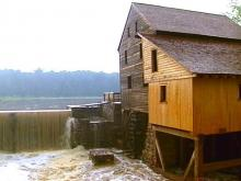 The water roars out of Yates Mill Pond.(WRAL-TV5 News)