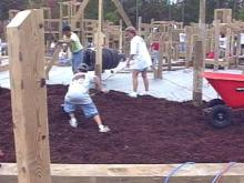 Volunteers hope to complete construction of this playground in Apex by Sunday to fulfill safety requirements. Volunteers are still needed to help meet the deadline.(WRAL-TV5 News)