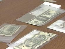 Police have confiscated 15 counterfeit bills since early December.(WRAL-TV5 News)