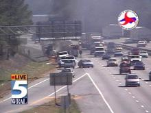 Traffic managed to keep moving as a vehicle went up in flames on the shoulder of I-40.(WRAL-TV5 News)