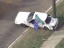 Police say a Ford Ranger rammed into the side of a Tri-City cab near an Interstate 440 entrance ramp Friday.(WRAL-TV5 News)