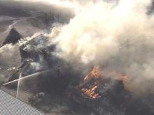 Flames raged out of control at F.L. Turlington Lumber Corporation early Thursday afternoon.(WRAL-TV5 News)