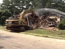 First Flood-Damaged Home Demolished Under Buyout Program