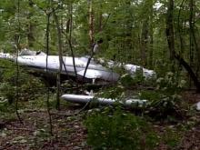 The plane wreckage is buried deep in the woods at Umstead Park.(WRAL-TV5 News)
