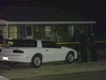 Yellow crime tape surrounds the home where the shooting occurred.(WRAL-TV5 News)