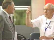 RDU volunteer ambassador Bud Holvay helps a traveler.(WRAL-TV5 News)