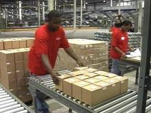 The new QVC distribution center brought 400 new jobs to the area, and another 400 people are scheduled to be hired over the next 12 months.(WRAL-TV5 News)