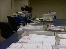 Wake County workers process provisional ballots.(WRAL-TV5 News)