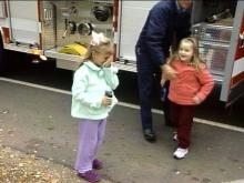 Two happy little girls bounced out of the firetruck.(WRAL-TV5 News)