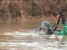 Divers search a Sampson County pond Saturday for any clues about Myers' disappearance.(WRAL-TV5 News)