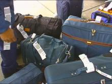 Three Midway Employees Accused Of Stealing Items From Unclaimed Luggage