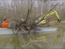 A barge is being used to pull out fallen trees and branches, left behind by Hurricane Floyd in Rocky Mount.(WRAL-TV5 News)