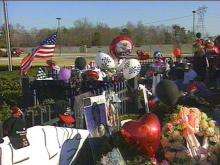 Dale Earnhardt fans came by early and often Monday to say goodbye to someone who many considered the greatest NASCAR driver of all time.(WRAL-TV5 News)