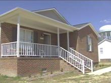 John and Mary Headen moved into their new home after their previous one was destroyed by Hurricane Floyd.(WRAL-TV5 News)