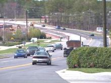 As crews repaint lines, each lane will lose about a foot in width.(WRAL-TV5 News)
