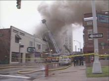 Firefighters were at the scene of a fire in downtown Durham Sunday morning. The fire destroyed two businesses and damaged several others.(WRAL-TV5 News)