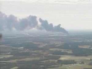 Smoke is seen from West Pharmaceutical plant following a Jan. 29, 2003, explosion and fire.